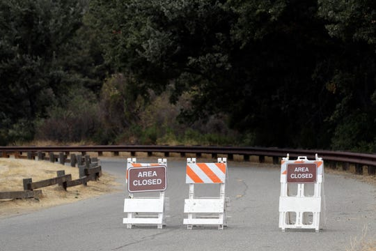 Signs indicate a road closure at the Malibu Creek State Park on Oct. 11, 2018, in Calabasas.
