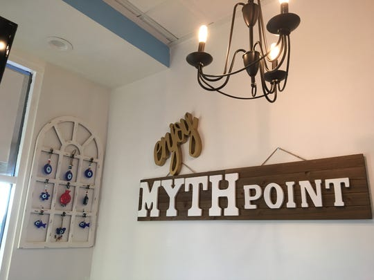 Decor at MythPoint Bistro in Thousand Oaks includes a display of evil-eye amulets, at left.
