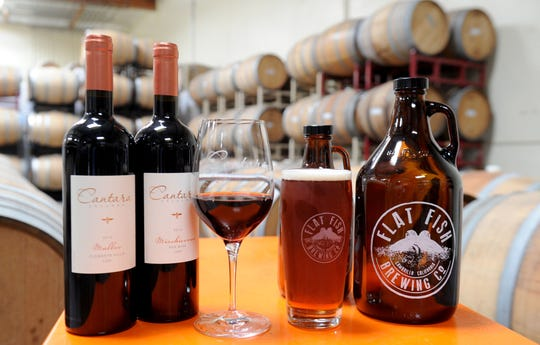 Lodi-sourced wines from Cantara Cellars and a pint of LongDrift IPA from Flat Fish Brewing Co. are seen at the combined winery-brewery space in Camarillo. Operated by the husband-and-wife team of Mike and Chris Brown with son Jesse Johnson, the business is thought to be the only one in the region to make, sell and serve wine and beer at the same address.