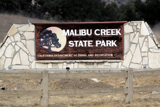 A sign is seen at the entrance to the Malibu Creek State Park on Oct. 11, 2018, in Calabasas.