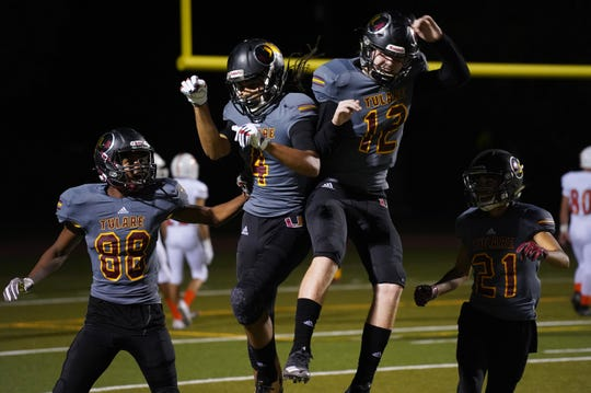 Tulare Union's offense celebrates a touchdown against Porterville during their football game on Thursday at Bob Mathias Stadium in Tulare.