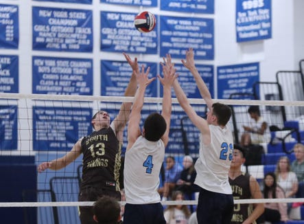 Suffern's Will Krebs (4) and Aidan Anderson (23) work to block a shot by Clarkstown South's Luke Pallogudis (13) during their 3-1 win in boys volleyball action at Suffern High School in Suffern on Thursday, October 11, 2018.
