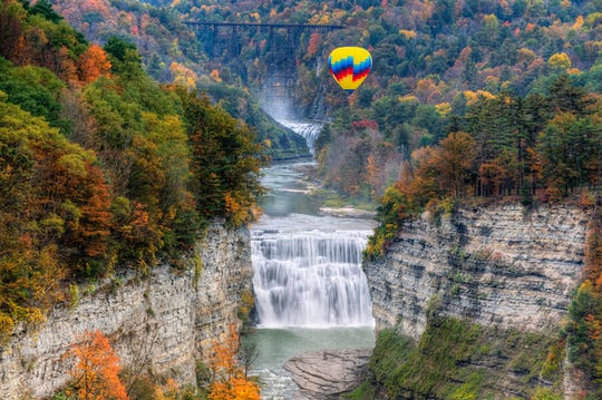Balloon over the Middle Falls at Letchworth State Park. Rides are given during fall foliage season.