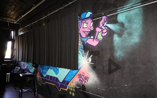 Graffiti art is pictured on walls of the Mes Hall, a recording and artist studio on Washington Street in Mount Vernon, Oct. 12, 2018.