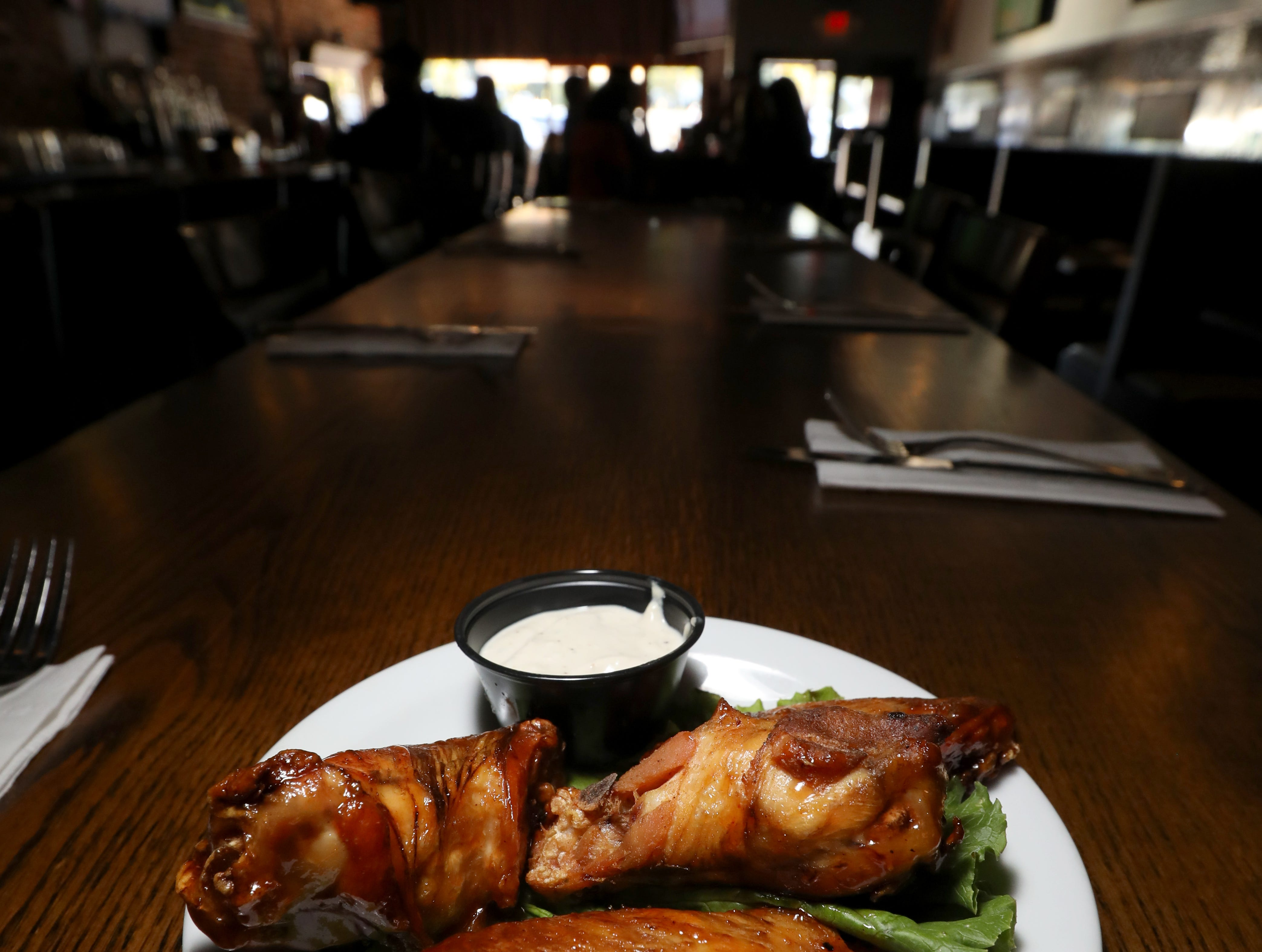 Smoked wings with black cherry barbecue sauce at the Foggy Bottom Tavern in New City Oct. 12, 2018.
