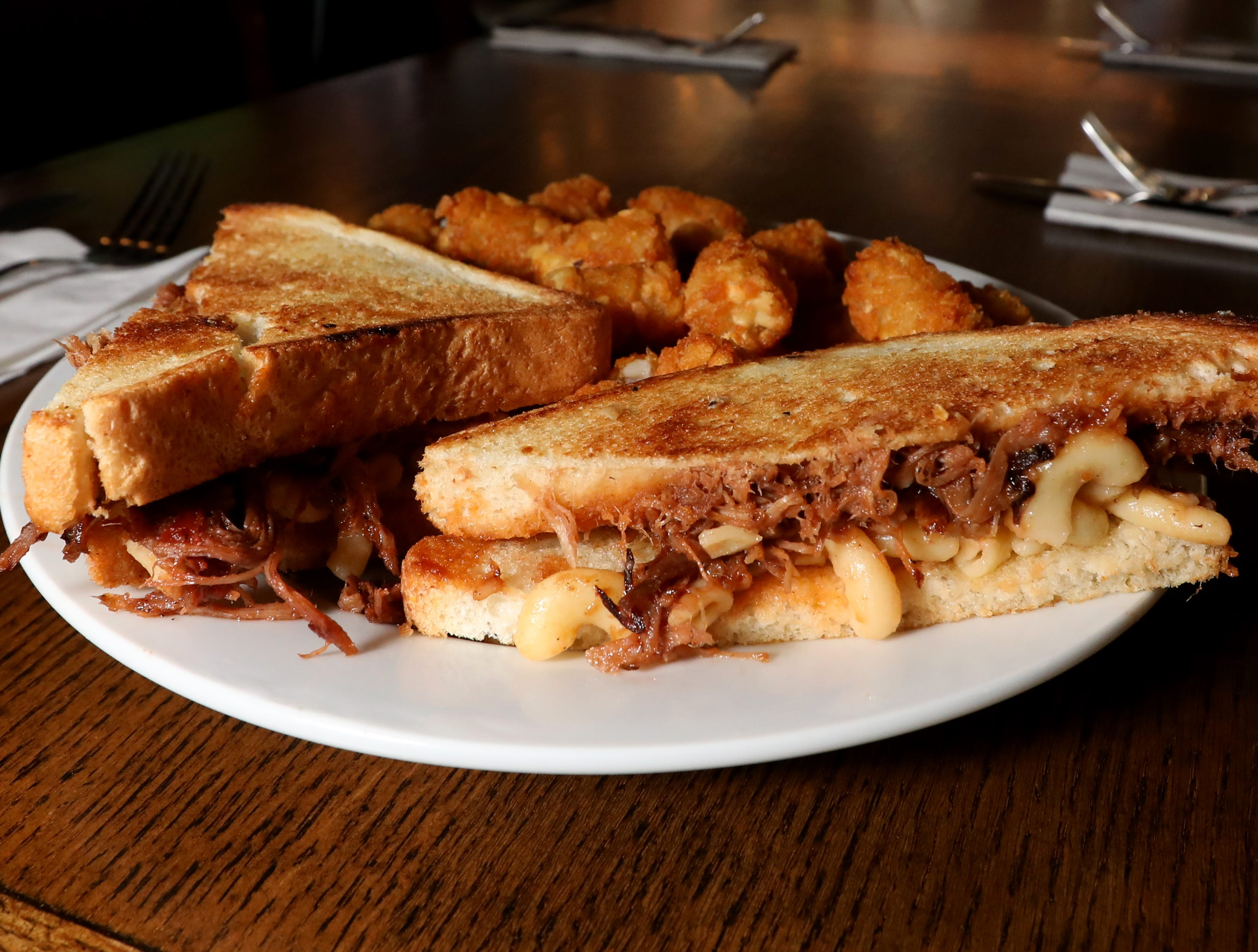 The Pork Sundae grilled cheese sandwich with pulled pork, gouda mac-n-cheese and bourbon bacon sauce at the Foggy Bottom Tavern in New City Oct. 12, 2018.