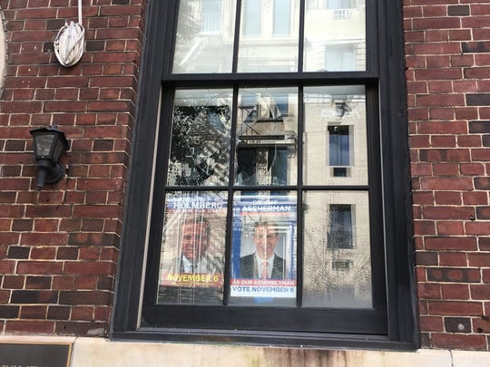Broken window at New York City GOP headquarters, vandalism that party leaders blamed on anarchists.