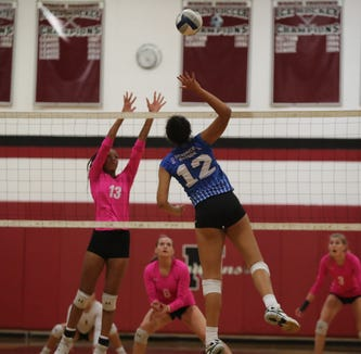 Hen Hud's Caitlin Weimar (12) puts up a shot against Nyack's Miah Barrow during their 3-0 in girls volleyball action at Nyack High School on Friday, October 12, 2018.