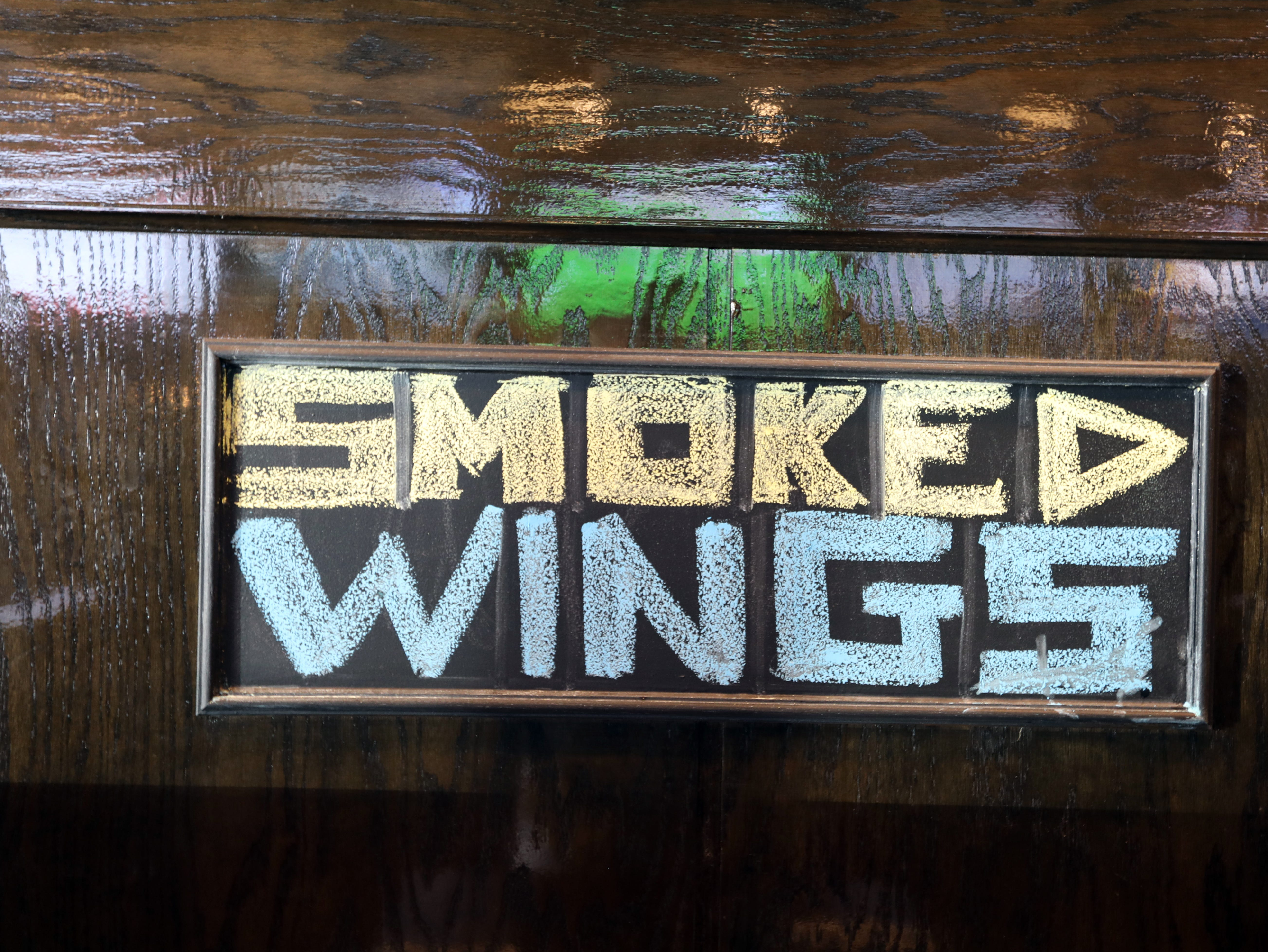 Smoked wings sign at the Foggy Bottom Tavern in New City Oct. 12, 2018.