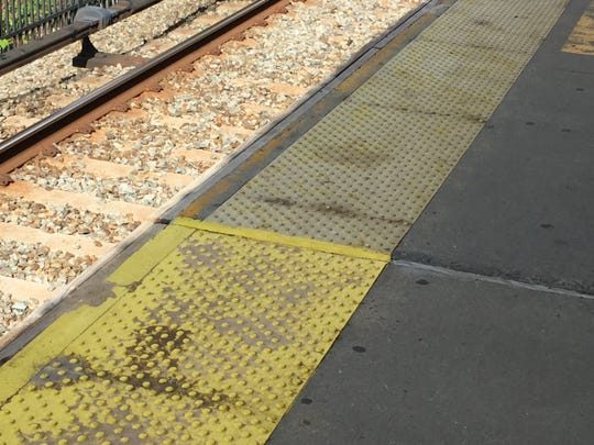 Yellow edge of White Plains train platform was recently re-painted.
