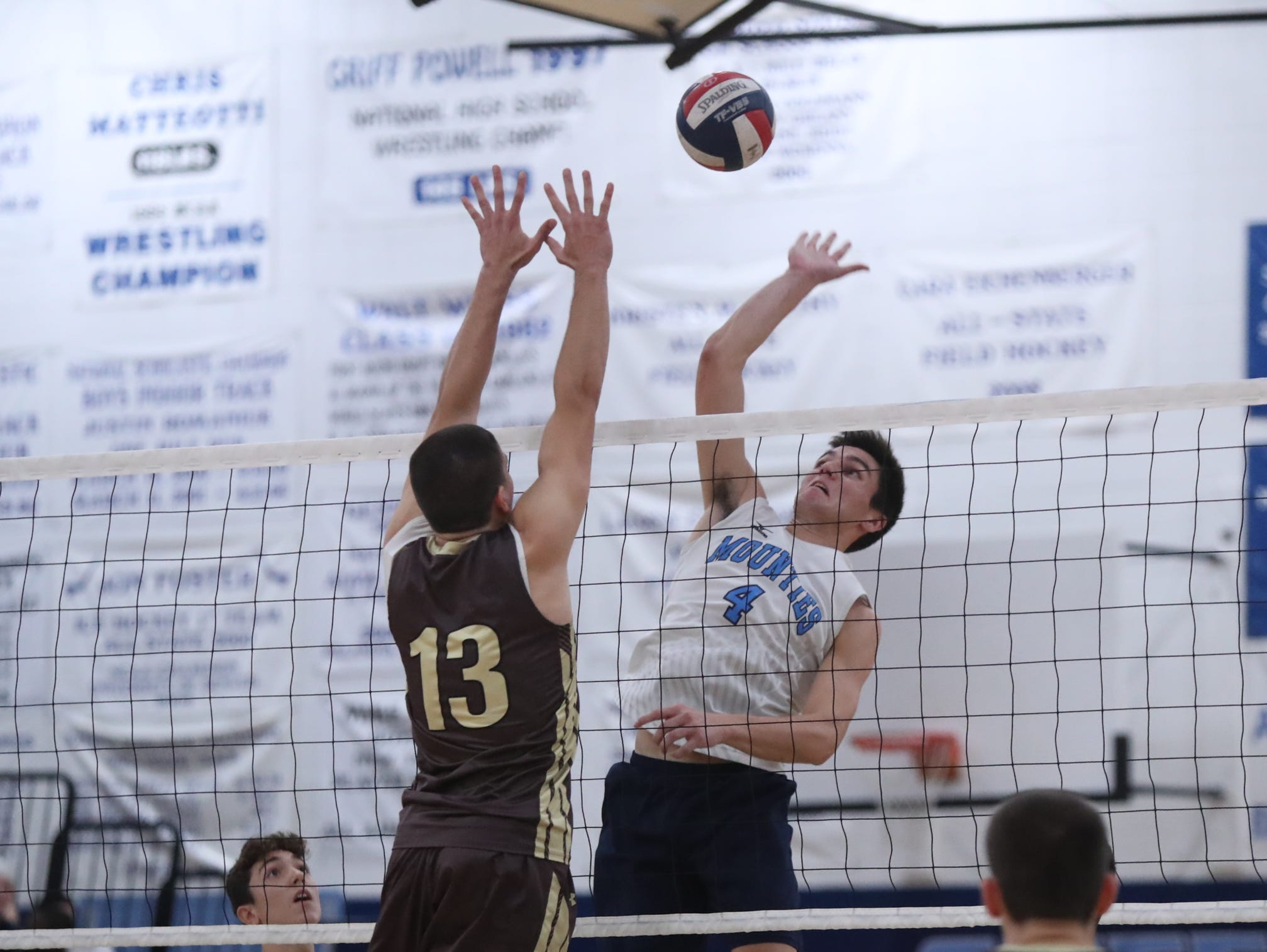 Suffern's Will Krebs (4) hits a shot as Clarkstown South's Luke Pallogudis (13) attempts a block during their 3-1 win in boys volleyball action at Suffern High School in Suffern on Thursday, October 11, 2018.