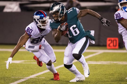 Eagles' DeAndre Carer (16) is tracked by New York's Jawill Davis (80) during a punt return Thursday, Oct. 12, 2018, at MetLife Stadium.