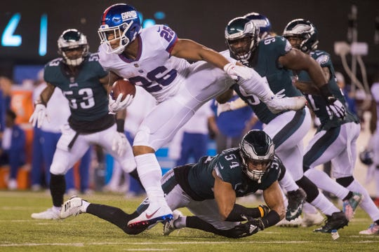New York's Saquon Barkley (26) hurdles Philadelphia's Kamu Grugier-Hill (54) Thursday at MetLife Stadium.