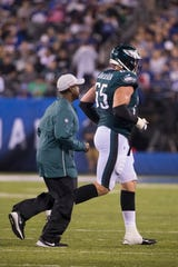 Eagles' Lane Johnson (65) jogs off the field with an injury Thursday at MetLife Stadium.