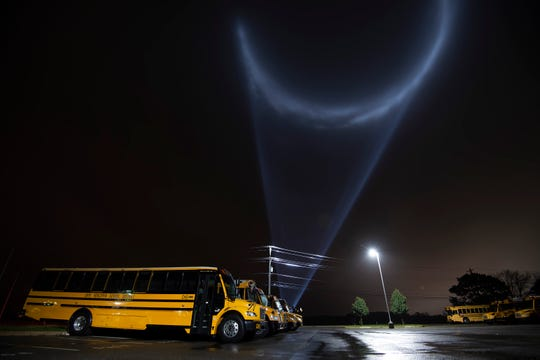A spot light for the Rehoboth Beach Jazz Festival shines in the clouds at Cape Henlopen High School as Hurricane Michael moves up the east coast and into Delaware.