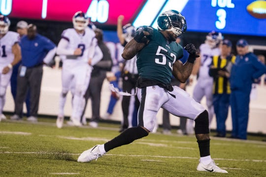 Eagles' Nigel Bradham (53) celebrates making a sack in October 2018 at MetLife Stadium.