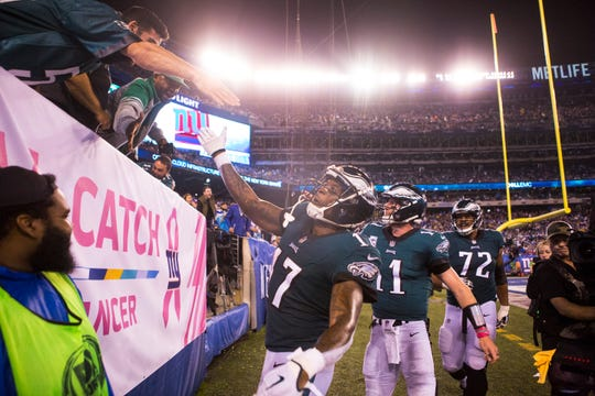 Eagles' Alshon Jeffery (17) celebrates scoring with fans Thursday against the New York Giants at MetLife Stadium.