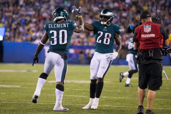 Eagles' Corey Clement (30) and Wendell Smallwood (28) celebrate a touchdown Thursday at MetLife Stadium