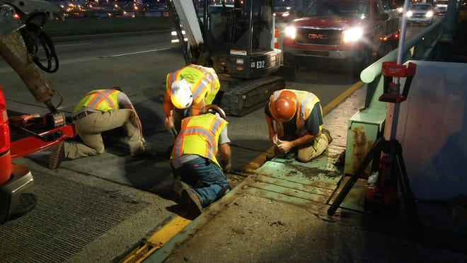 Workers turn their attention to a joint expansion on the Delaware Memorial Bridge.