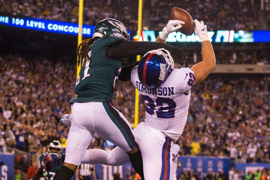 Eagles' Ronald Darby, left, breaks up a pass intended for New York's Scott Simonson Thursday at MetLife Stadium