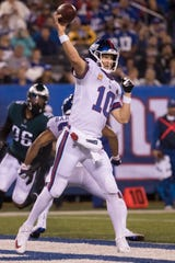 New York's Eli Manning throws downfield at MetLife Stadium.