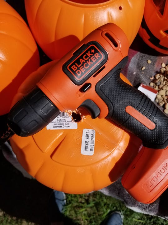 Using your drill and a drill bit, that is the same size as your garden stake or rebar, drill a hole in the bottom of your plastic pumpkin.