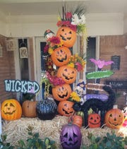 Add in the rest of your own Halloween and fall decorations.  Put in some small hay bales, a few more pumpkins, a spooky sign or two. Maybe a skull. It's Halloween!