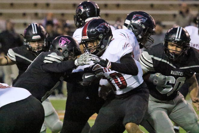 Wichita Falls High School junior Isaiah Cherry (10) made the move to running back and has been a natural fit for the Coyotes.