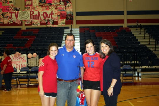 David Sanders with his wife Meredith and daughters Sarah, left, and Marleigh. Sarah is a sophomore at Graham High School now and Marleigh is a sophomore at Baylor.