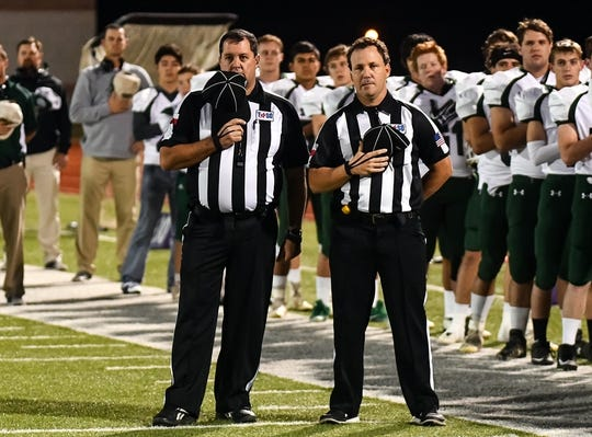 David Sanders, left, with best friend and fellow official Troy Wolfe before calling a football game together.