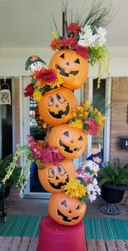 Decorate your pumpkins.  Put in seasonal silk flowers, grass and reeds.  Add in a couple of small scarecrows.  Maybe throw in some smaller pumpkins.