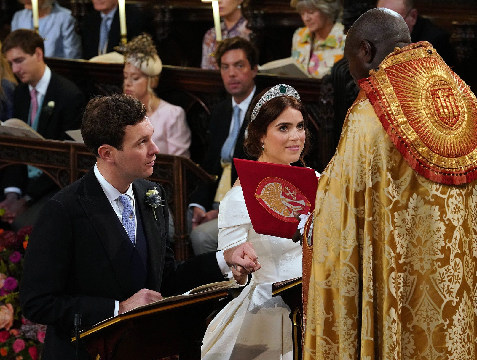 Britain's Princess Eugenie of York and Jack Brooksbank kneel at the altar during their wedding ceremony at St George's Chapel.
