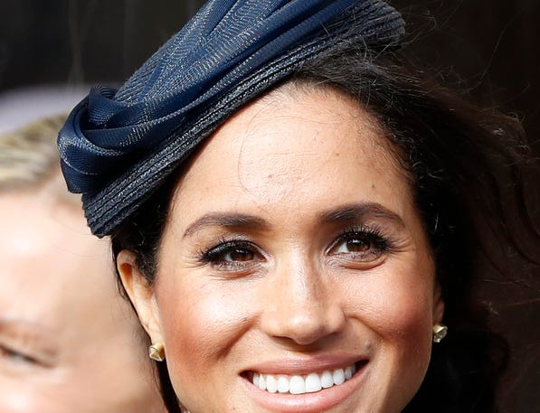 Meghan, Duchess of Sussex, waits for the bridal procession after the wedding of Princess Eugenie of York and Mr. Jack Brooksbank.
