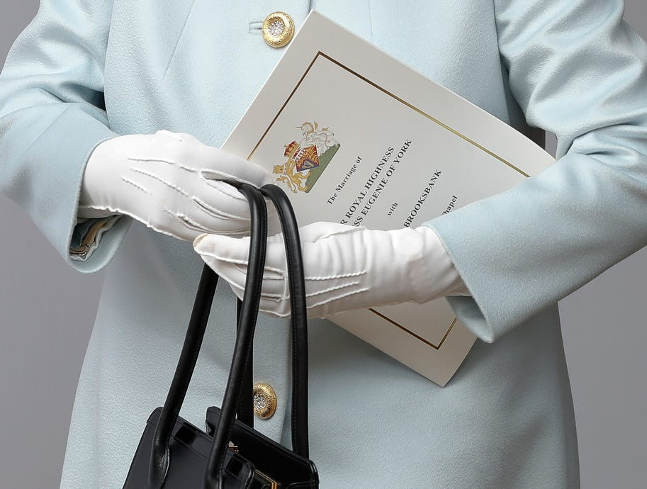 Britain's Queen Elizabeth II holds the program for the wedding of Princess Eugenie of York and Jack Brooksbank.