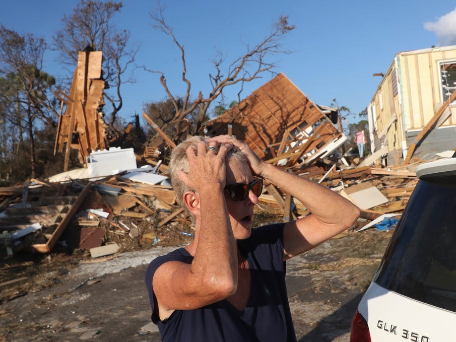 Becky Daniel reacts to seeing her Beacon Hill home, behind her, on Oct. 11, 2018. It was destroyed in Hurricane Michael. The area is right next to Mexico City, which was ground zero for the hurricane.