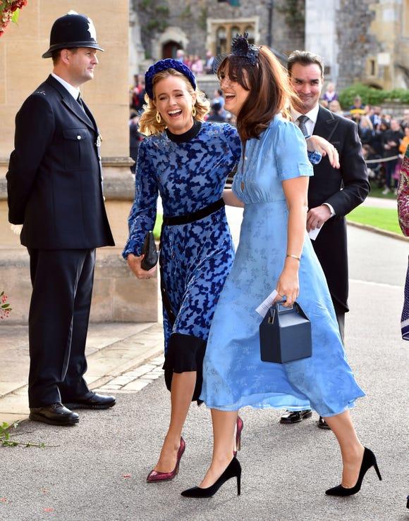 Cressida Bonas, left, arrives for the wedding of Princess Eugenie of York and Jack Brooksbank at St George's Chapel, Windsor Castle, near London, England, Friday Oct. 12, 2018.