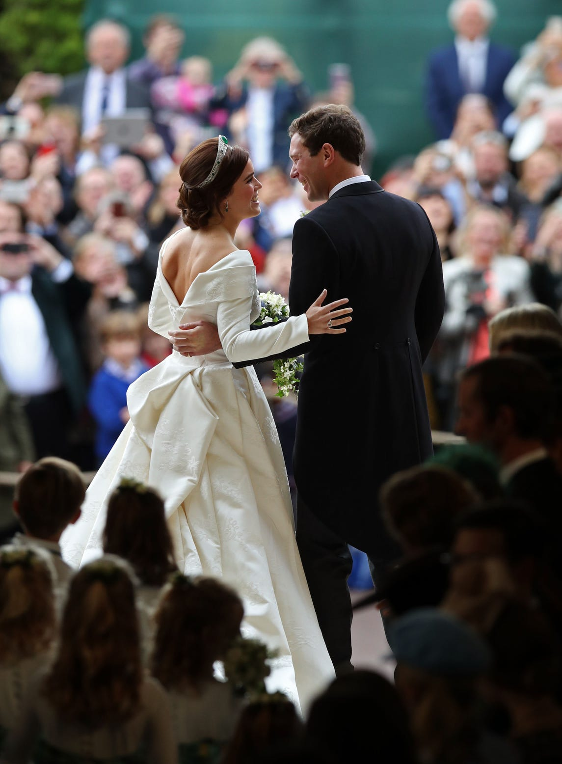 Princess Eugenie of York and Mr. Jack Brooksbank embrace after they were wed at St. George's Chapel on October 12, 2018 in Windsor, England.