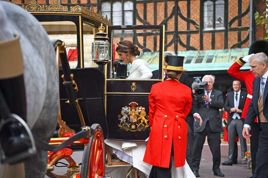 Thankfully, Eugenie got a glass-enclosed carriage. Her hairspray may not have been up to the job of keeping her tressed tied down in the blustery wind.