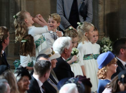 The bridesmaids and page boys, including Prince George and Princess Charlotte, arrive for the wedding of Princess Eugenie on Oct. 12, 2018.