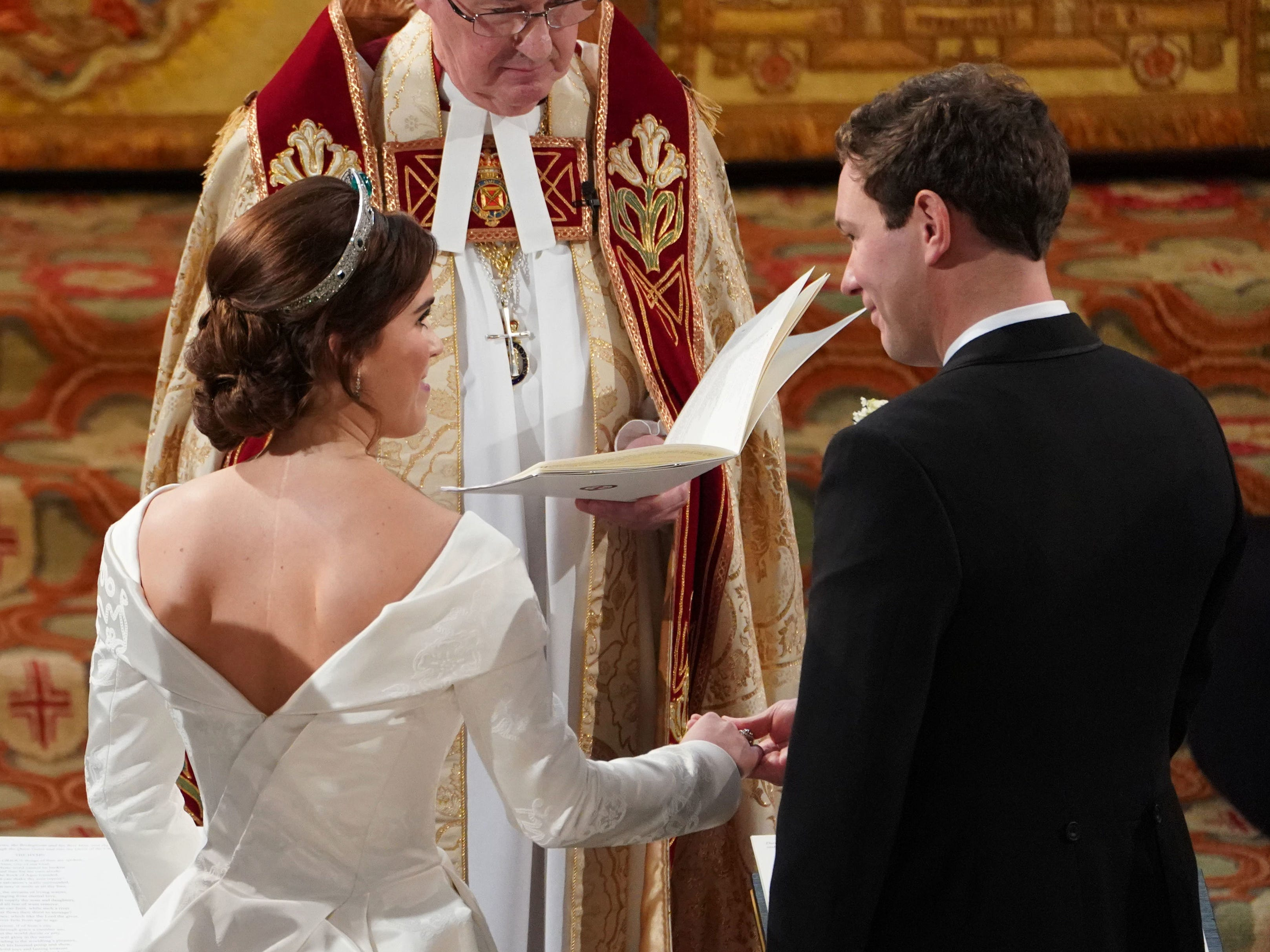 WINDSOR, ENGLAND - OCTOBER 12: Jack Brooksbank and Princess Eugenie of York during their wedding ceremony at St. George's Chapel on October 12, 2018 in Windsor, England. (Photo by Owen Humphreys - WPA Pool/Getty Images) ORG XMIT: 775239781 ORIG FILE ID: 1051954332