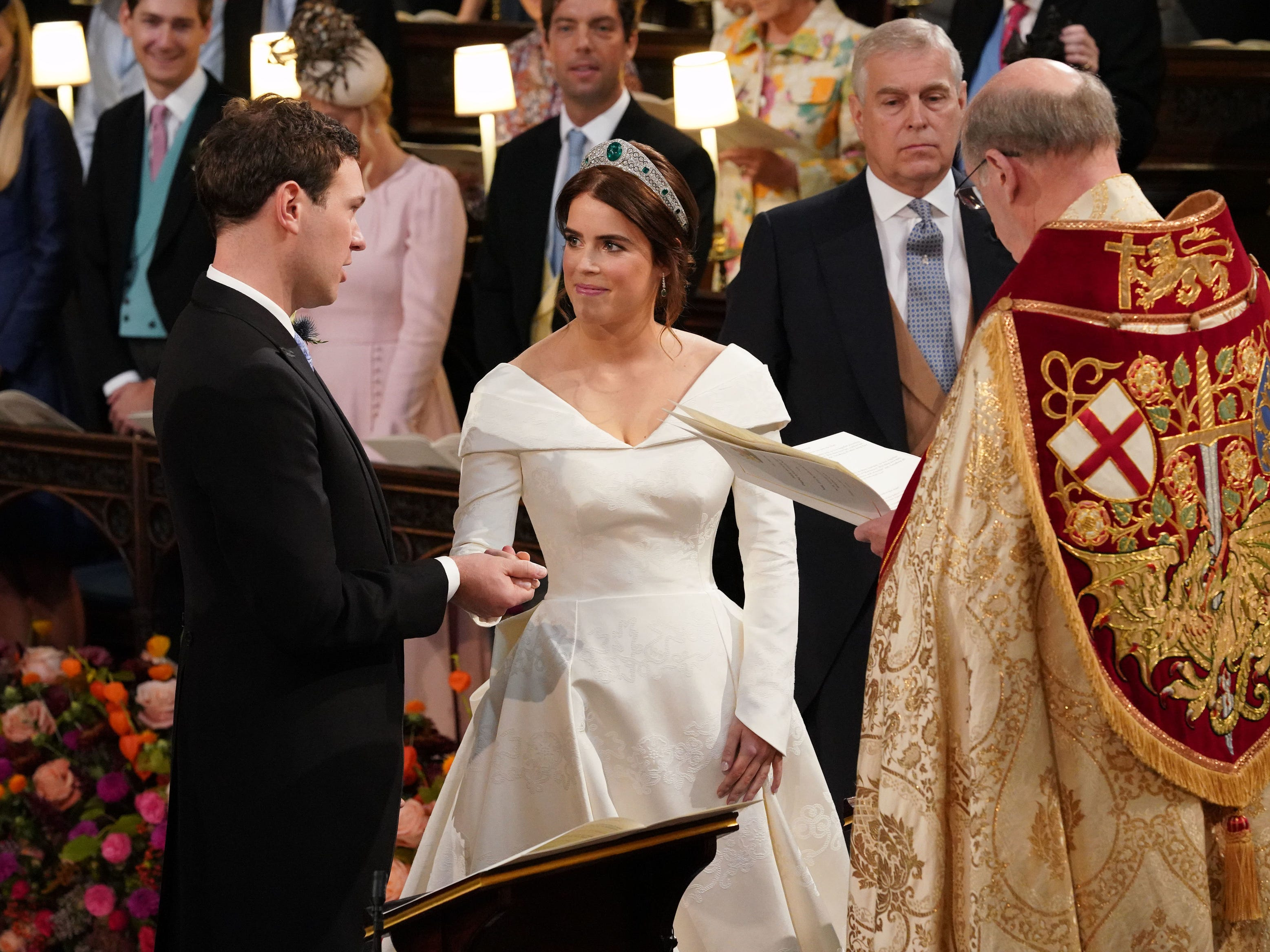 WINDSOR, ENGLAND - OCTOBER 12:  Dean of Windsor, David Conner (R) presides over the wedding ceremony of Princess Eugenie of York and Mr. Jack Brooksbank at St. George's Chapel on October 12, 2018 in Windsor, England. (Photo by Jonathan Brady - WPA Pool/Getty Images) ORG XMIT: 775239781 ORIG FILE ID: 1051951158