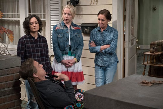 "Darlene (Sara Gilbert), standing to the left, Becky (Lecy Goranson) and Jackie (Laurie Metcalf) stand over Dan (John Goodman), in the front left, in ""The Conners"" on ABC."