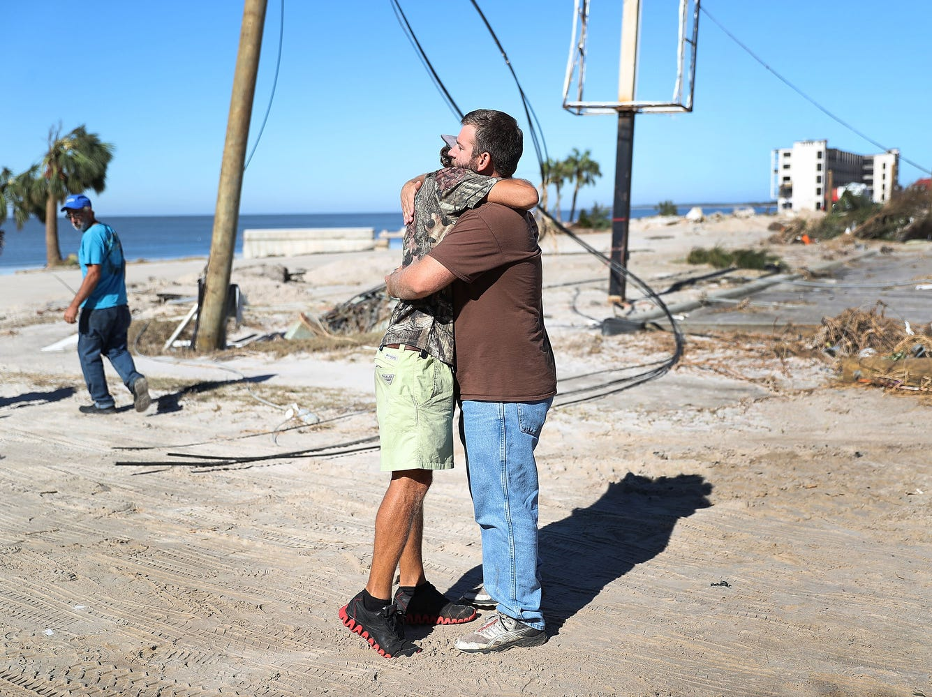 Kevin Guaranta hugs Henry Kirby after they see each other is okay for the first time since Hurricane Michael passed through the area on Oct. 12, 2018, in Mexico Beach, Fla.