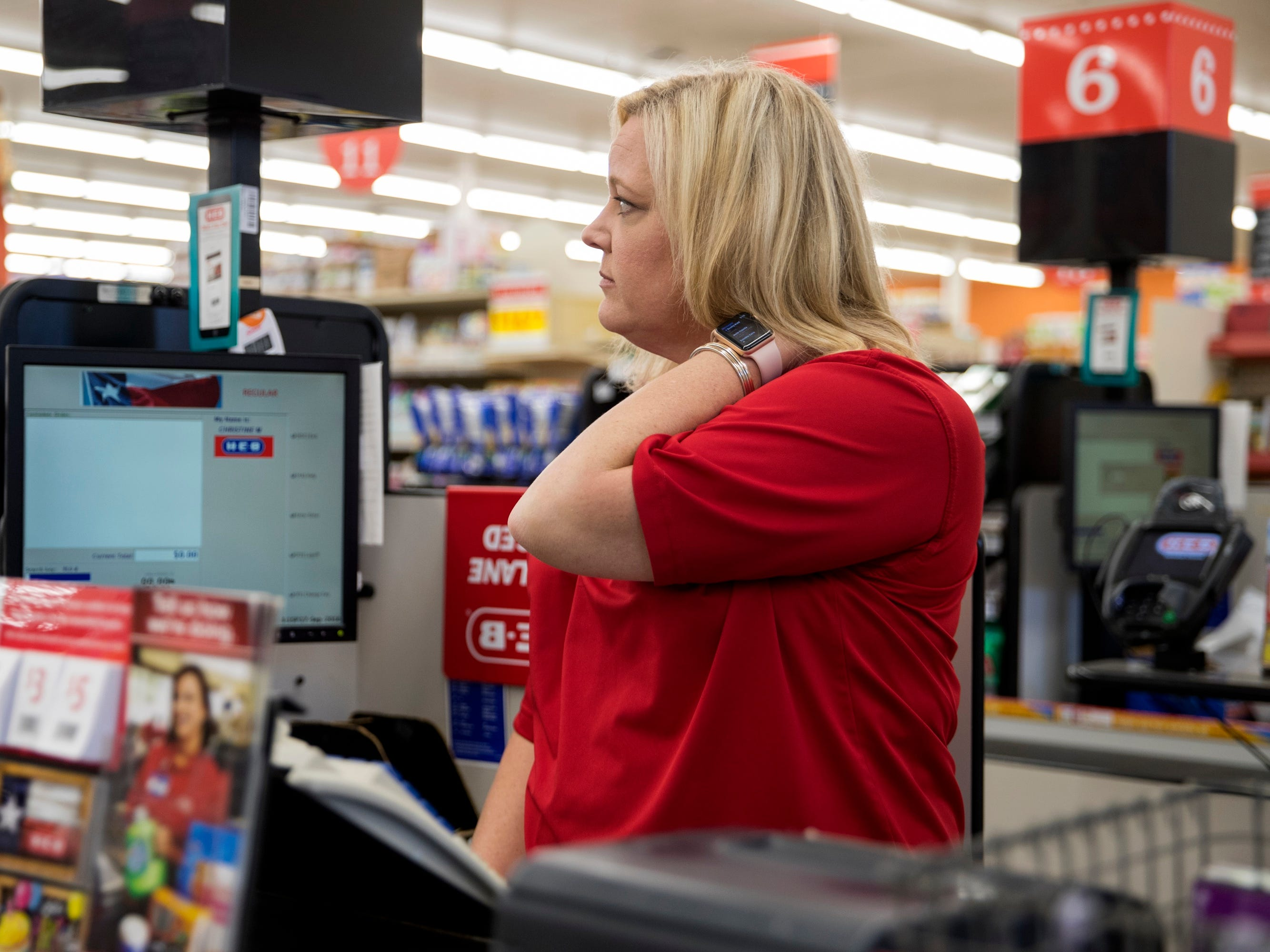 "Sinton, TX – Christine McFarland, a fifth-grade teacher at Sinton Elementary School, rubs her neck as she waits for a customer to check out at H-E-B, a grocery store.Three years ago, she said she applied for free or reduced lunch for her son. ""I'm a teacher. And I qualified for reduced lunch. What does that say?"""