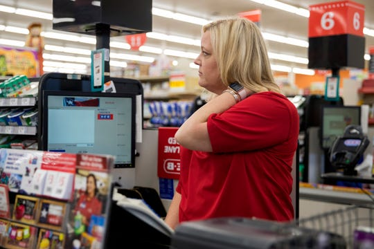 """Sinton, TX –Christine McFarland, a fifth-grade teacher at Sinton Elementary School, rubs her neck as she waits for a customer to check out at H-E-B, a grocery store.Three years ago, she said she applied for free or reduced lunch for her son. """"I'm a teacher. And I qualified for reduced lunch. What does that say?"""""""