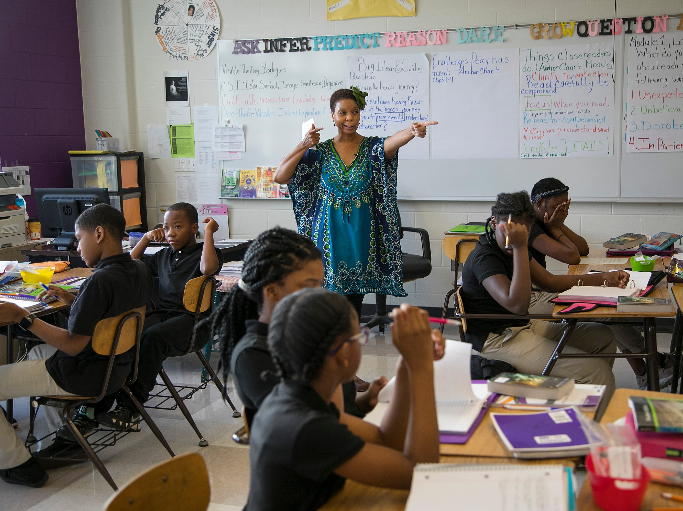 Detroit, MI – Felecia Branch talks about hitting the bullseye as she teaches her first hour sixth grade class at Mackenzie Elementary-Middle School.