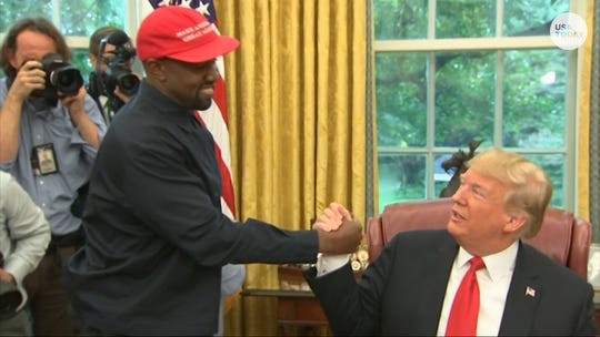 Kanye West told President Donald Trump he loved him during a meeting in the White House Oval Office.
