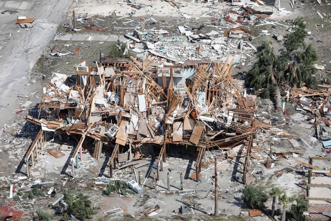 A CBP Air and Marine Operations UH-60 Black Hawk flight crew image shows a search and rescue operation mission after Hurricane Michael damaged homes in Panama City, Florida.