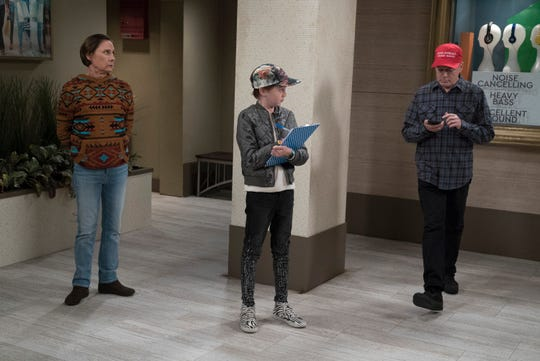 Trump supporter Roseanne may have departed, but 'The Conners' will still address contemporary politics as it does in an upcoming episode where young Mark (Ames McNamara), center, conducts an election survey as Jackie (Laurie Metcalf), left, observes.