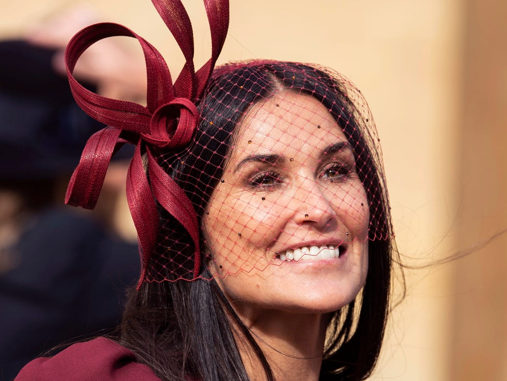 Demi Moore leaves after the royal wedding ceremony of Princess Eugenie of York and Jack Brooksbank.